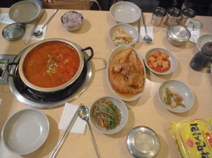 Kimchi stew and accompanying side dishes
